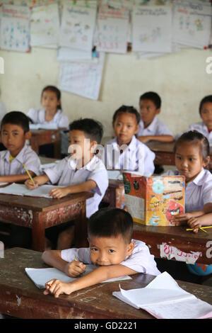 Schoolchildren in classroom, elementary school, Vang Vieng, Vientiane Province, Laos, Indochina, Southeast Asia, - Stock Photo