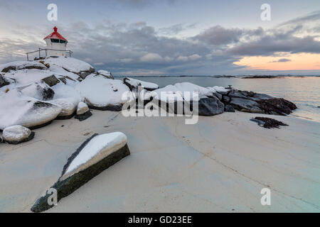 Colorful arctic sunset on the lighthouse surrounded by snow and icy sand, Eggum, Vestvagoy Island, Lofoten Islands, - Stock Photo