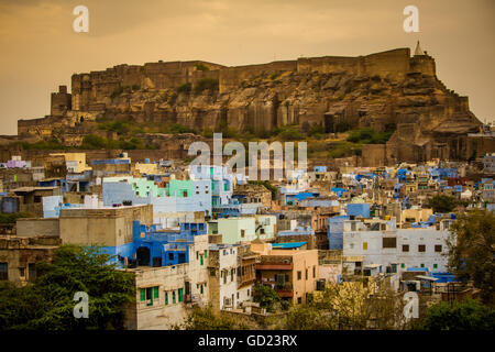 Mehrangarh Fort towering over the blue rooftops in Jodhpur, the Blue City, Rajasthan, India, Asia - Stock Photo