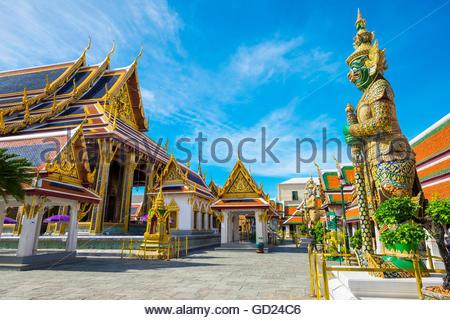 Yaksha Thotsakhirithon statue in front of Phra Ubosot, Temple of the Emerald Buddha, Grand Palace complex, Bangkok, - Stock Photo