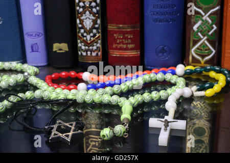 Bibles and Quran, interfaith symbols of Christianity, Islam and Judaism, the three monotheistic religions, Haute - Stock Photo