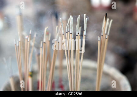 Close-up of incense sticks burning, Wat Si Muang (Simuong) Buddhist temple, Vientiane, Laos, Indochina, Southeast - Stock Photo