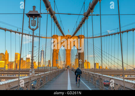 Manhattan, Brooklyn Bridge over East River, Lower Manhattan skyline, inc Freedom Tower of World Trade Center, New - Stock Photo