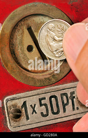 money / finances, coins, 50 pfennig, money slot at an old automate from the early fifties, Germany, circa 1955, - Stock Photo