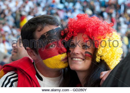 sports, football / soccer, World Football Championship 2010, German football supporter  couple with face paint, - Stock Photo