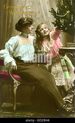 Christmas, Christmas card, 'Gesegnete Weihnachten', mother and daughter celebrating together, Germany, 1909, Additional - Stock Photo
