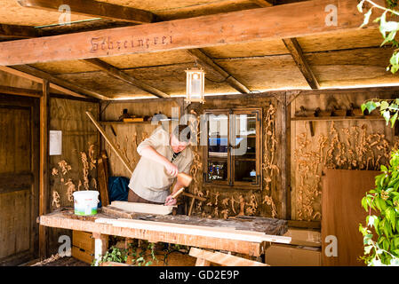 Friedberg, Germany - July 09, 2016: A man dressed in traditional costume is working as a carpenter in his workshop - Stock Photo