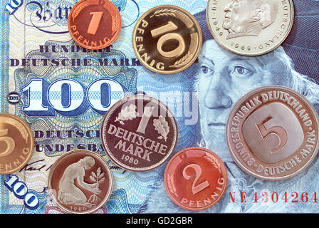 money / finances,coins,Germany,German Mark,100 Mark banknote,valid from 1950 until 2001,coins year of minting: 1980,penny,hundred - Stock Photo