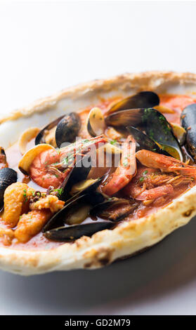 mussels shrimp and fish seafood and spicy tomato puttanesca marinara pasta - Stock Photo
