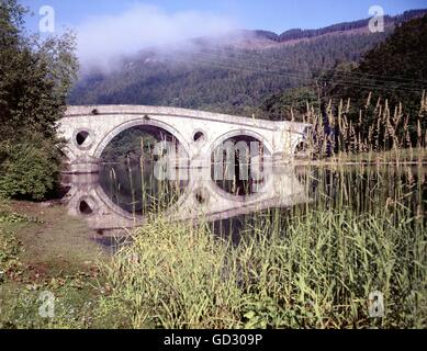 Scotland, Perthshire. Misty morning sunlight on the bridge over the River Tay at Kenmore. Circa 1980    Scanned - Stock Photo