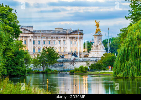 Buckingham Palace seen from St. James Park in London - Stock Photo