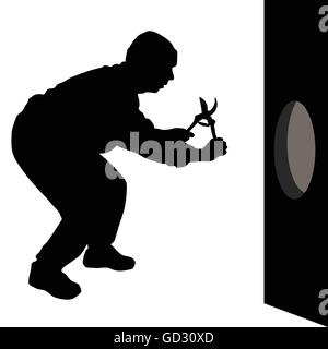 man with scissors is going to the hole in the wall - Stock Photo