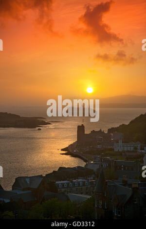 Sunset over oban and the Queen Mary II liner, Oban, Argyll, Scotland - Stock Photo