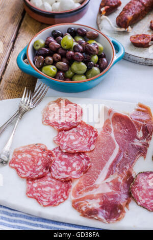 traditional spanish tapas served on table - Stock Photo