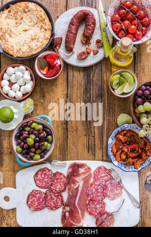 tapas background, overhead on wooden table - Stock Photo