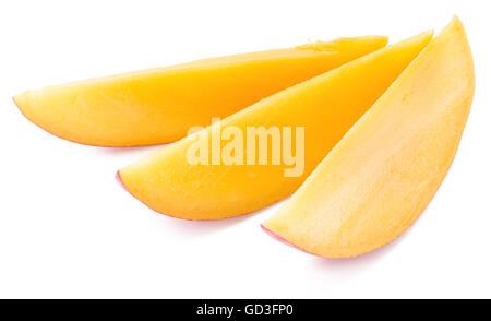 Mango slices. Isolated on a white background. - Stock Photo