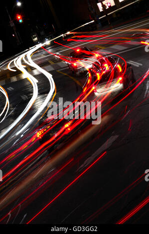 Light trails from traffic on the street, nighttime scenic - Stock Photo