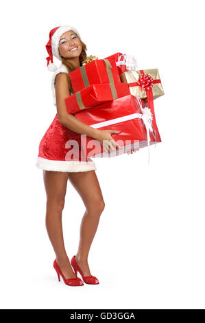 Smiling young woman with Christmas gifts - Stock Photo