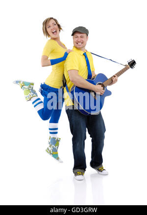 Happy young couple, man playing the guitar and woman dancing - Stock Photo