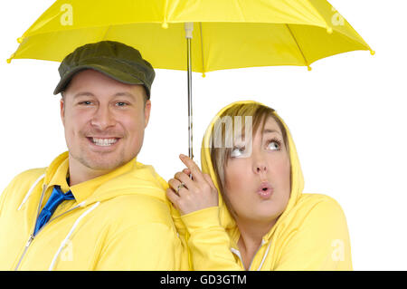 Happy young couple under an umbrella - Stock Photo