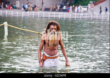 Sadhu bathing in river, kumbh mela, Nasik, maharashtra, india, asia - Stock Photo