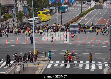Participants running in marathon, tokyo, japan - Stock Photo