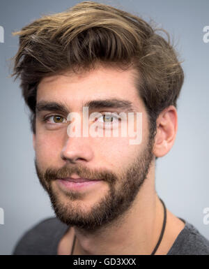 Berlin, Germany. 8th July, 2016. Singer Alvaro Soler smiles for the photographer in Berlin, Germany, 8 July 2016. - Stock Photo