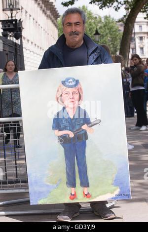 London, UK 12th July 2016, Mr Kaya Mar displays his painting of the future Prime Minister The Rt Hon Theresa May - Stock Photo