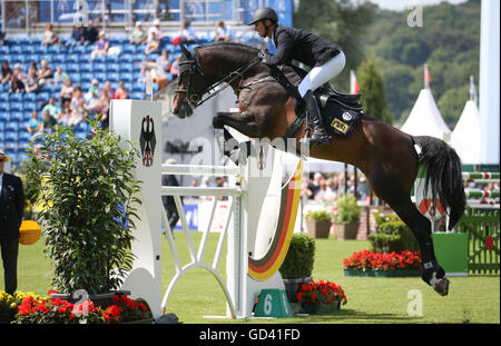 Aachen, Germany. 12th July, 2016. German show jumper Marco Kutscher on horse Van Gogh in action during the opening - Stock Photo