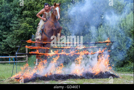 65-year-old vocational Native American and stuntman Wolfgang Kring jumps across a burning fire wall during a training - Stock Photo