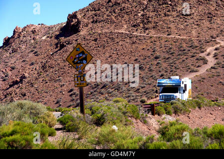 Rental RV Driving on Mountain Road - Stock Photo