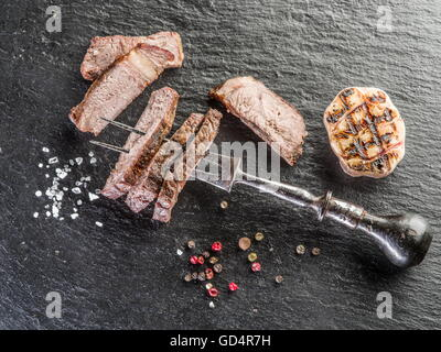 Steak Rib eye with spices on the graphite board. - Stock Photo