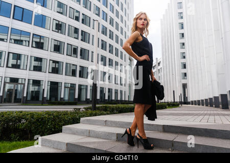 Full growth blonde woman in business suit and high heels - Stock Photo