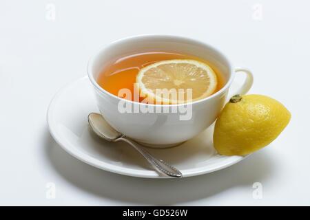 Tasse Schwarzer Tee mit Zitrone - Stock Photo