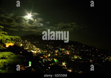 Moonlight view of Shimla town - Stock Photo