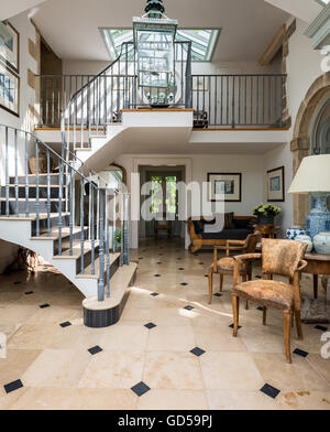... Old Leather Bridge Chairs And Round Table In Entrance Hall With Stone  And Metal Staircase