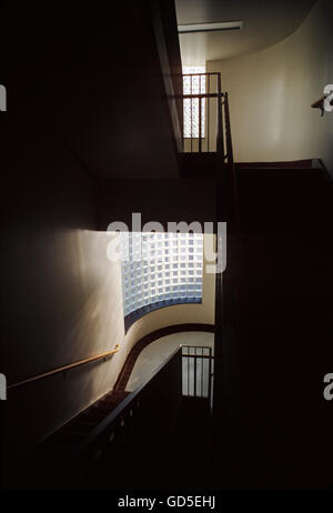 Sun streaming through block glass wall in a stairwell, American College, Bryn Mawr, Pennsylvania, USA - Stock Photo