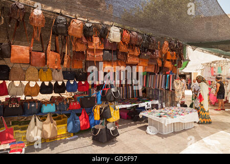 Leather handbags for sale in a market stall, Alcudia, Mallorca ( Majorca ), Balearic Islands, Spain, Europe - Stock Photo