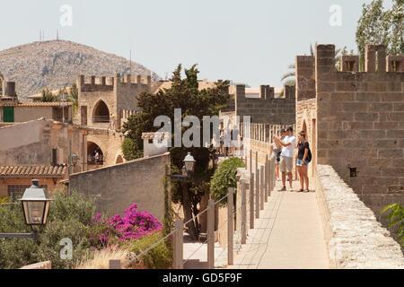 People walking the old town walls, Alcudia, Mallorca, ( Majorca ), Balearic Islands, Spain Europe - Stock Photo