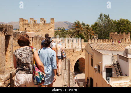 People walking the old town walls, Alcudia, Mallorca, ( Majorca ), Balearic Islands, Spain Europe - Stock Photo