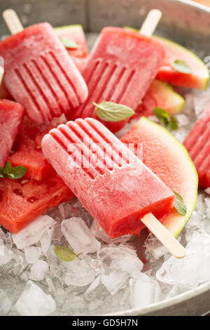 Watermelon and strawberry popsicles - Stock Photo