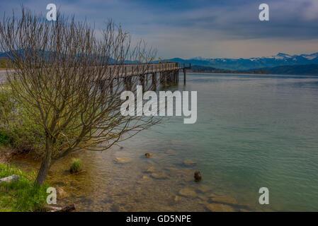 Holzsteg, a wooden pedestrian bridge connecting over the Upper Zurich Lake - Stock Photo