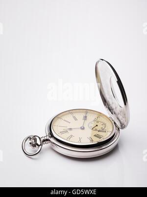 Pocket watch on white background - Stock Photo