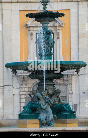 Public fountain in central Lisbon, Portugal - Stock Photo