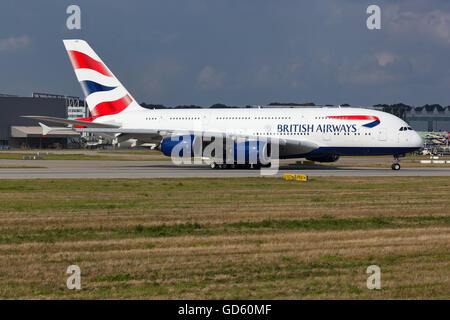 British Airways Airbus A380 G-XLEG lining up on the Runway of Airbus Factory Hamburg-Finkenwerder. - Stock Photo