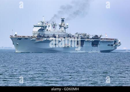 Amphibious assault ship HMS Ocean arriving at the Port of Kiel, Germany. - Stock Photo
