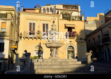 Baroque fountain in Piazza del Duomo at sunrise - Taormina, Sicily, Italy - Stock Photo