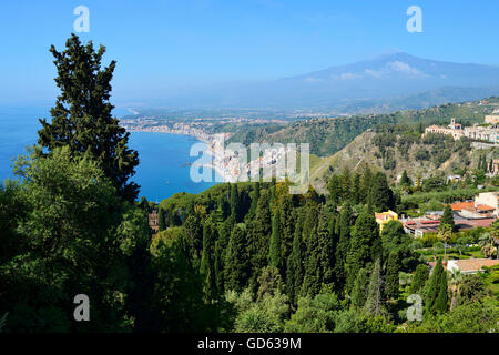 View of Mount Etna and east coastline from Taormina, Sicily, Italy - Stock Photo