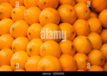 Pile of Fresh Orange Fruits Crop Texture Background - Stock Photo