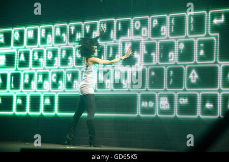 Female Contemporary Dancer performs in front of a computer keyboard backdrop - Stock Photo